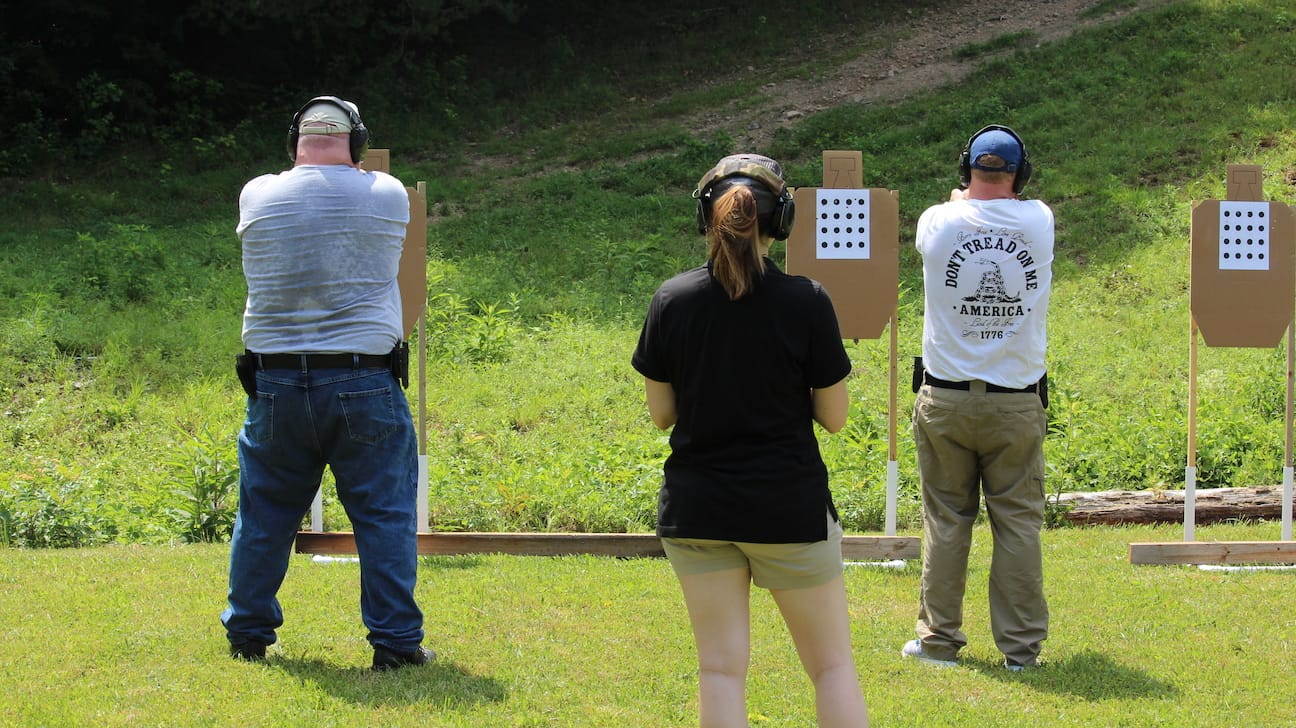Brooke coaching marksmanship